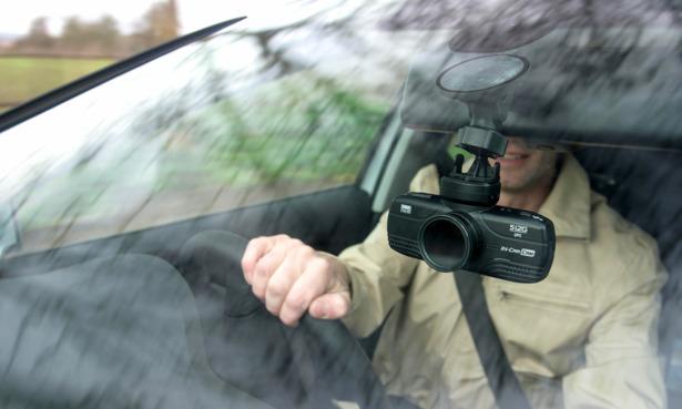 Dash cam positioned in a car windsheild
