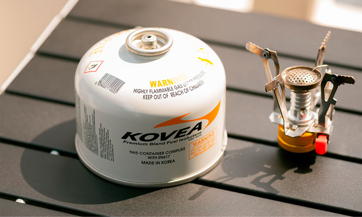 Small camping stove and gas canister
