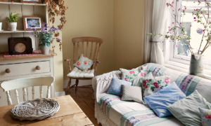 cottagecore style room with sofa, table, cushions