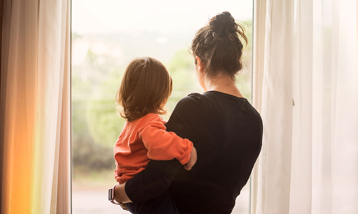 Mother and child waiting by the window