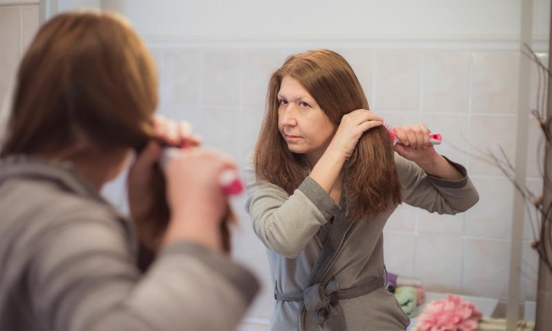 lady brushing her hair