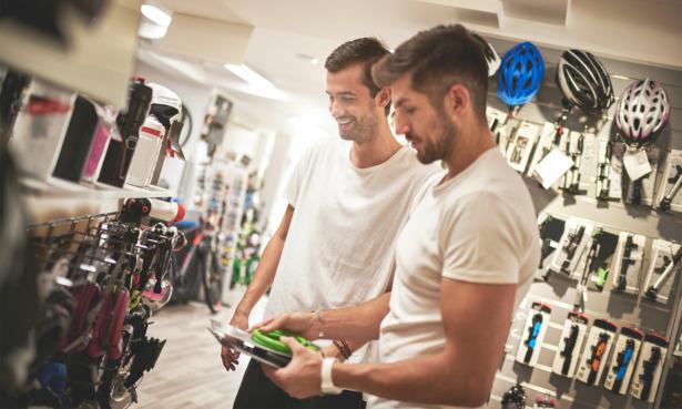 two men buying bike locks in a shop