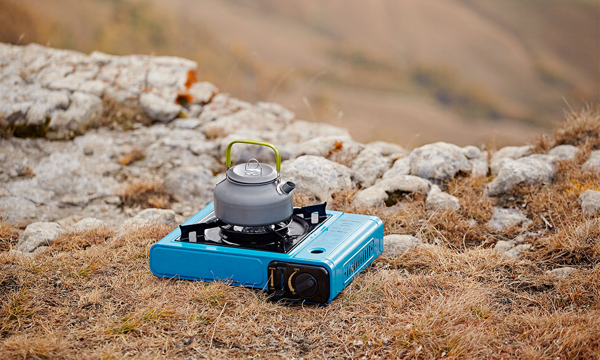 Camping stove in an open space