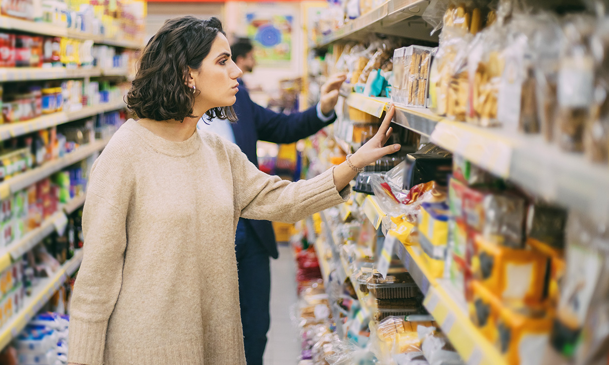 Shoppers browsing supermarket shelves