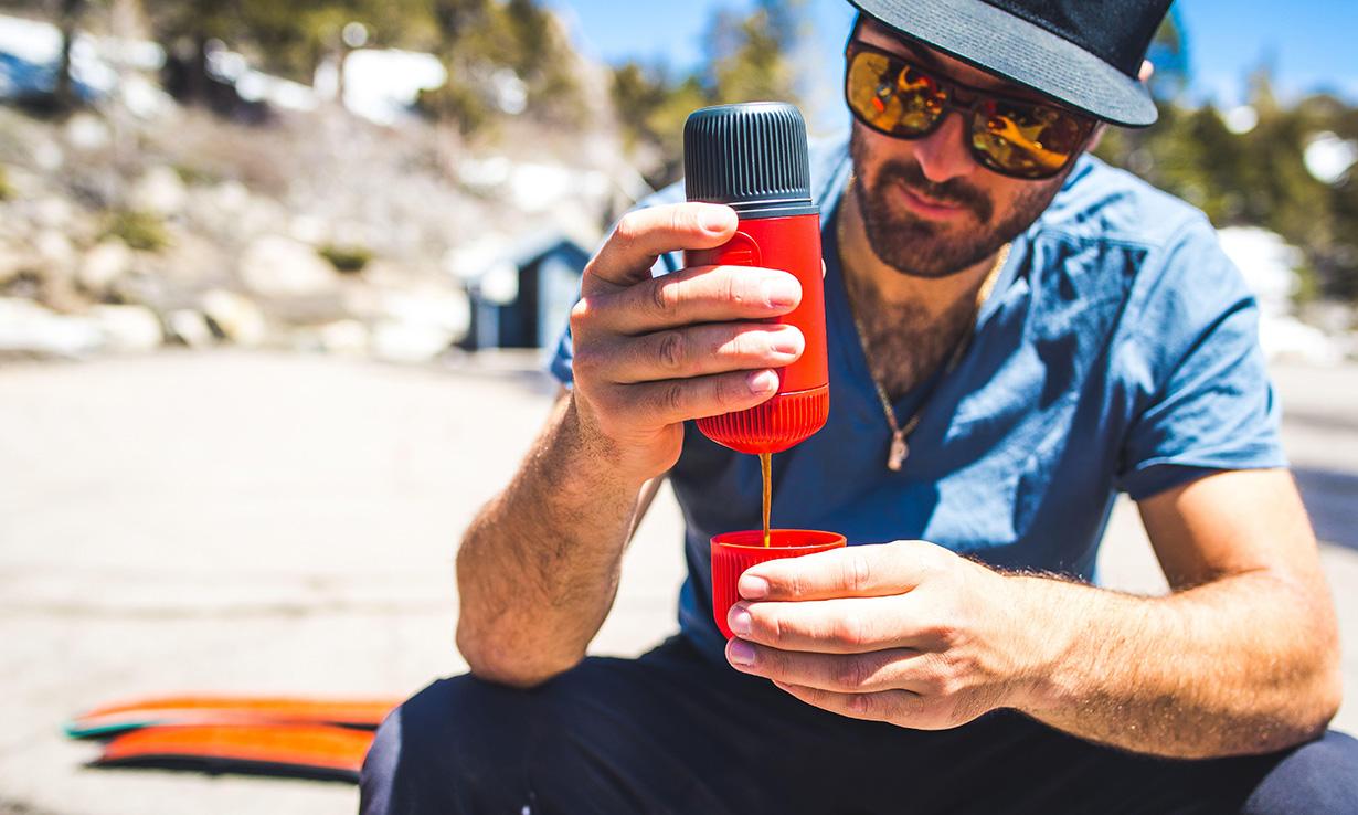 Man using a portable coffee maker