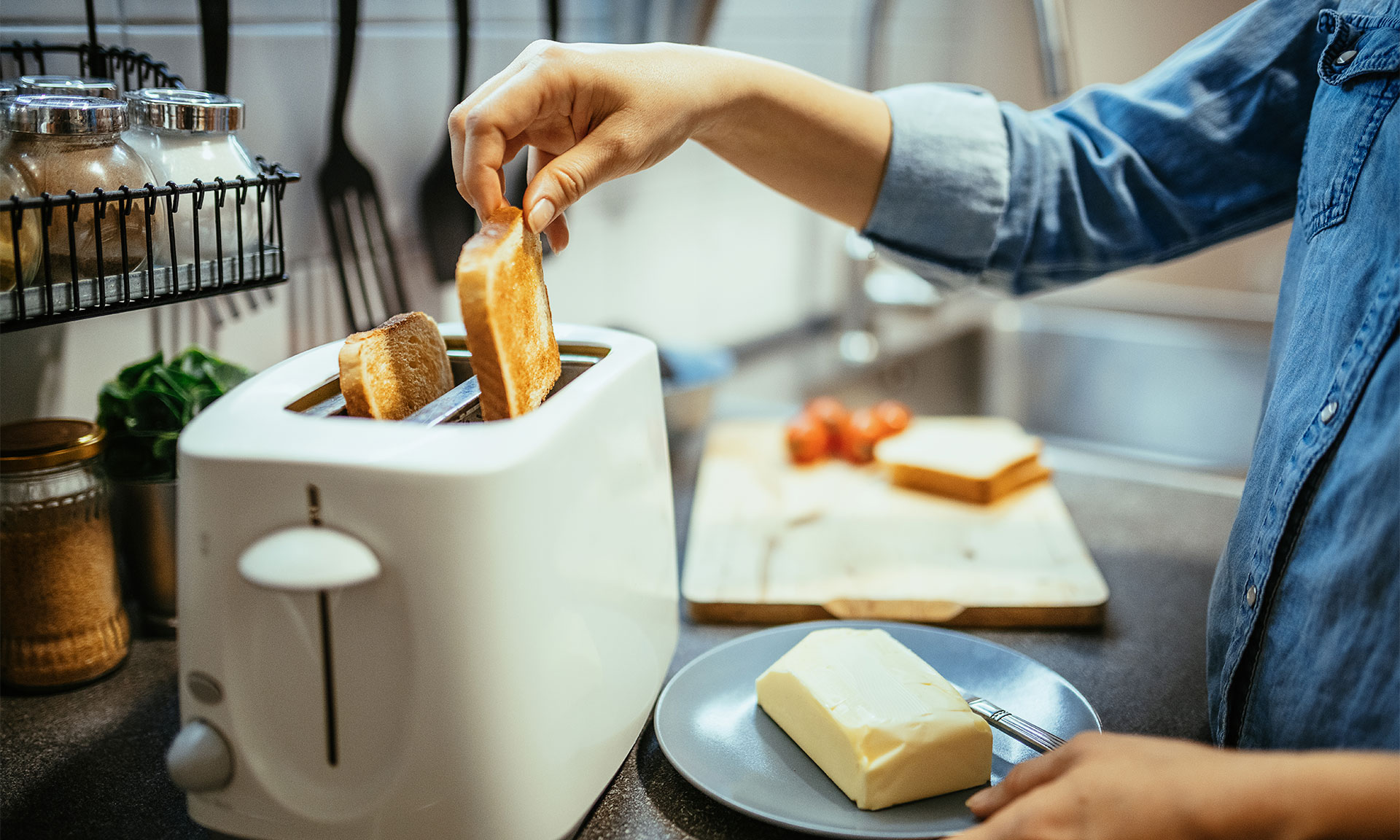 Person removing slices of toast from a toaster