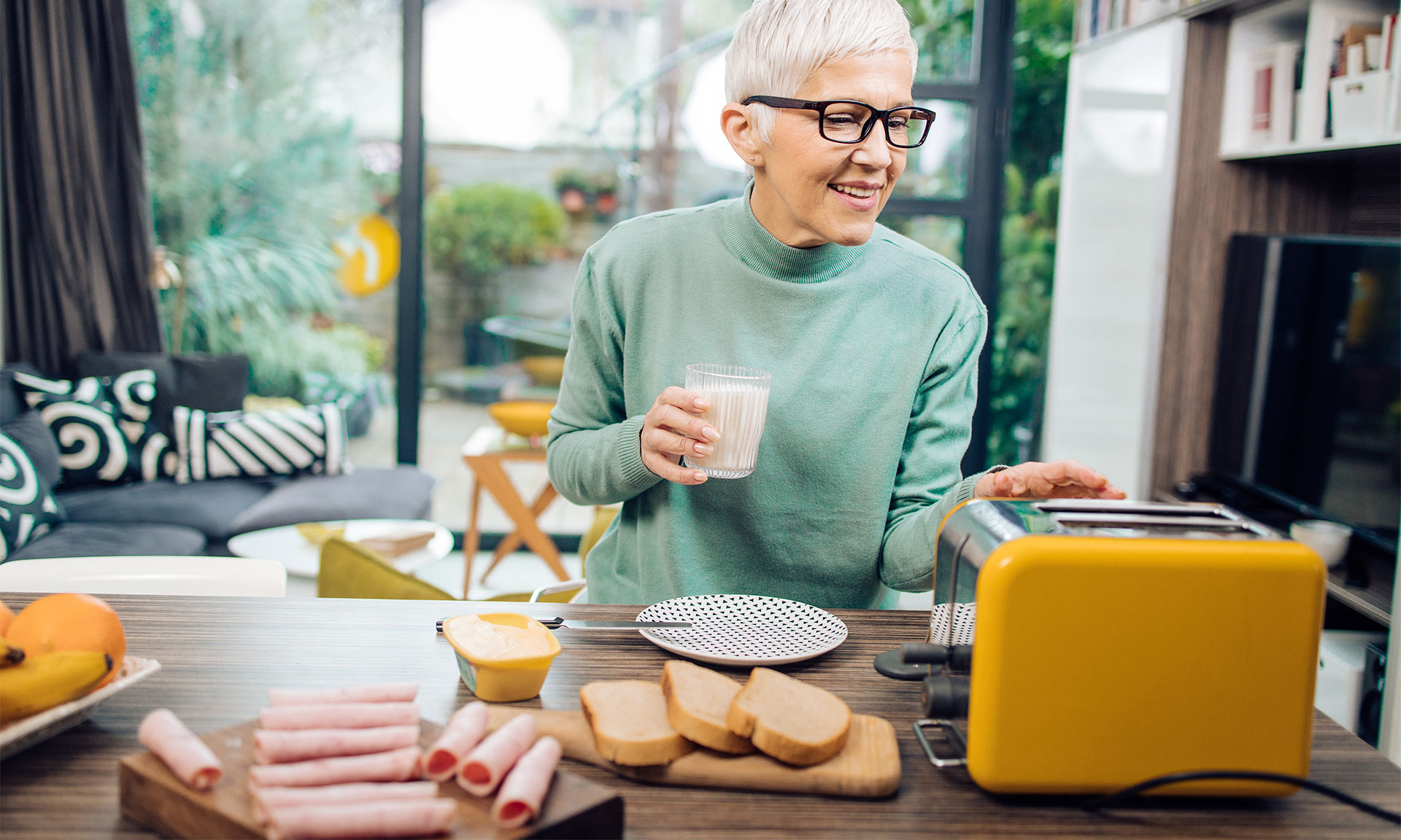 Woman using a toaster