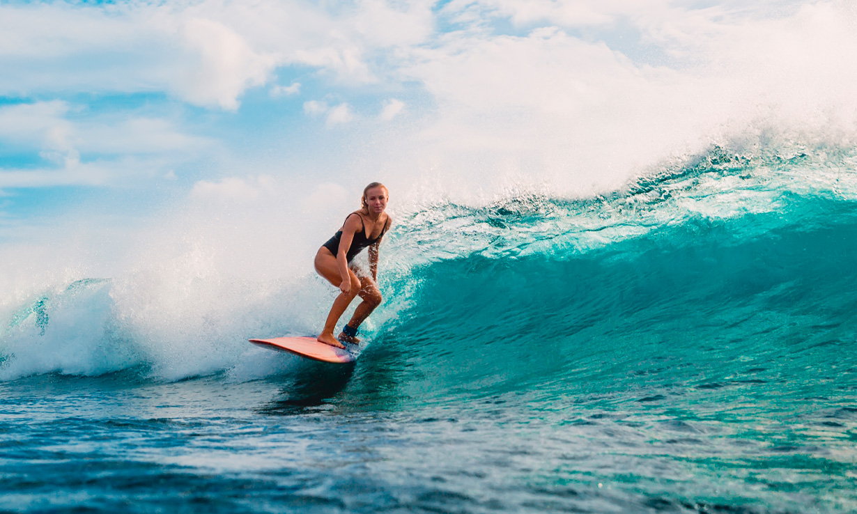A young woman surfing