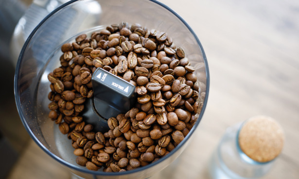 Coffee grinder filled with coffee beans