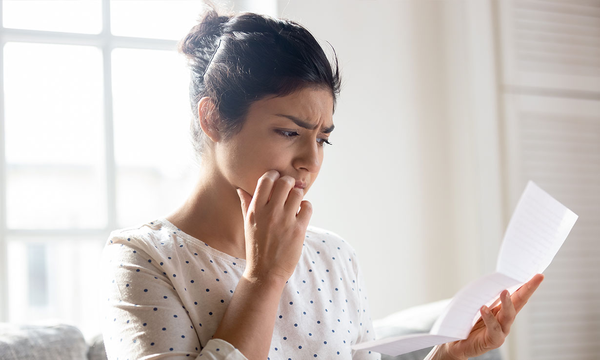Woman worrying about energy bill