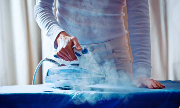 Man ironing with steam