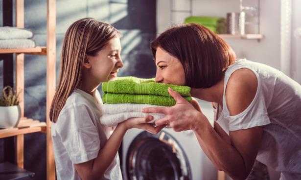 Woman smelling fresh laundry