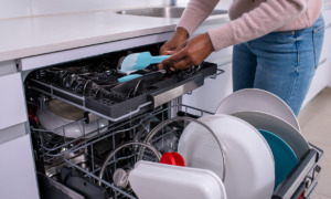 a dishwasher being loaded