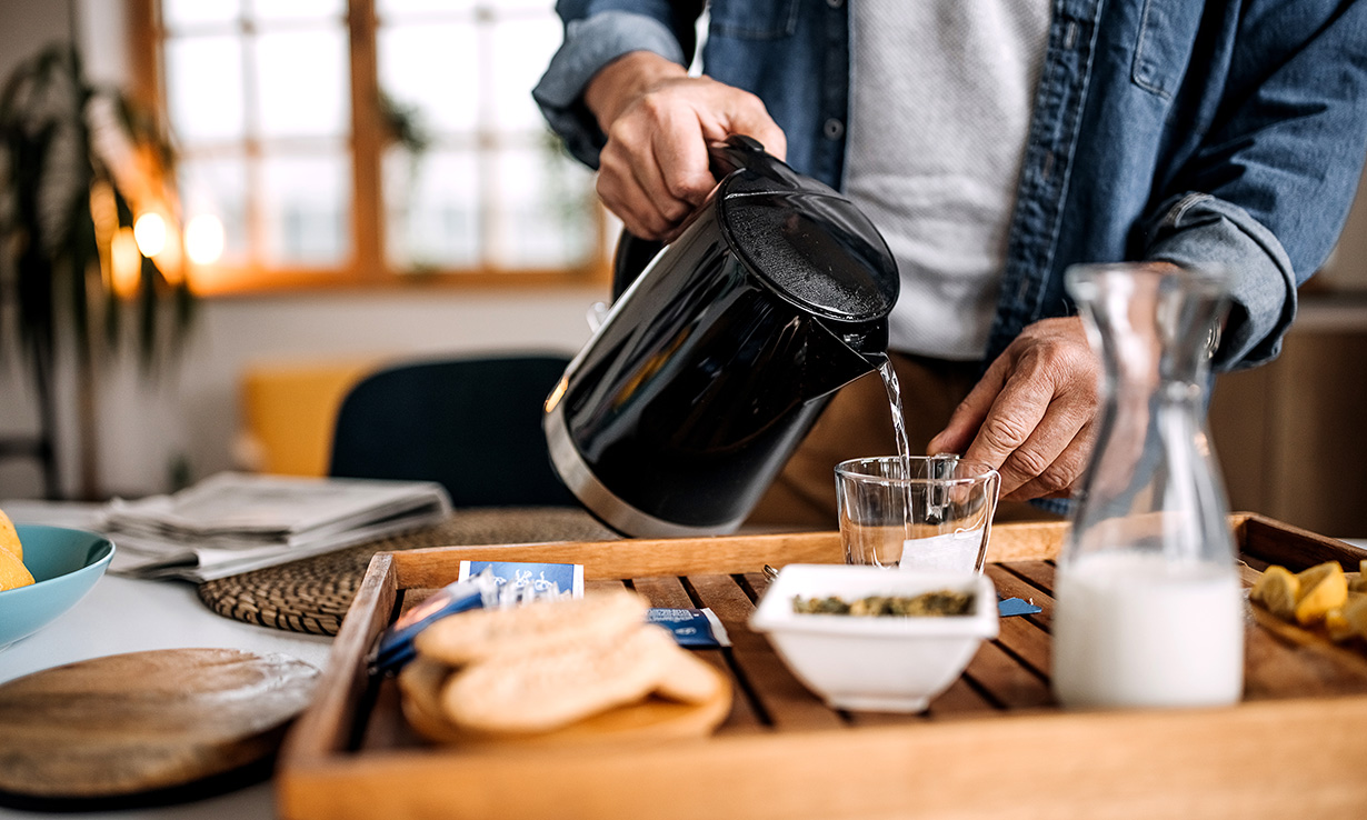Man pouring water from a kettle