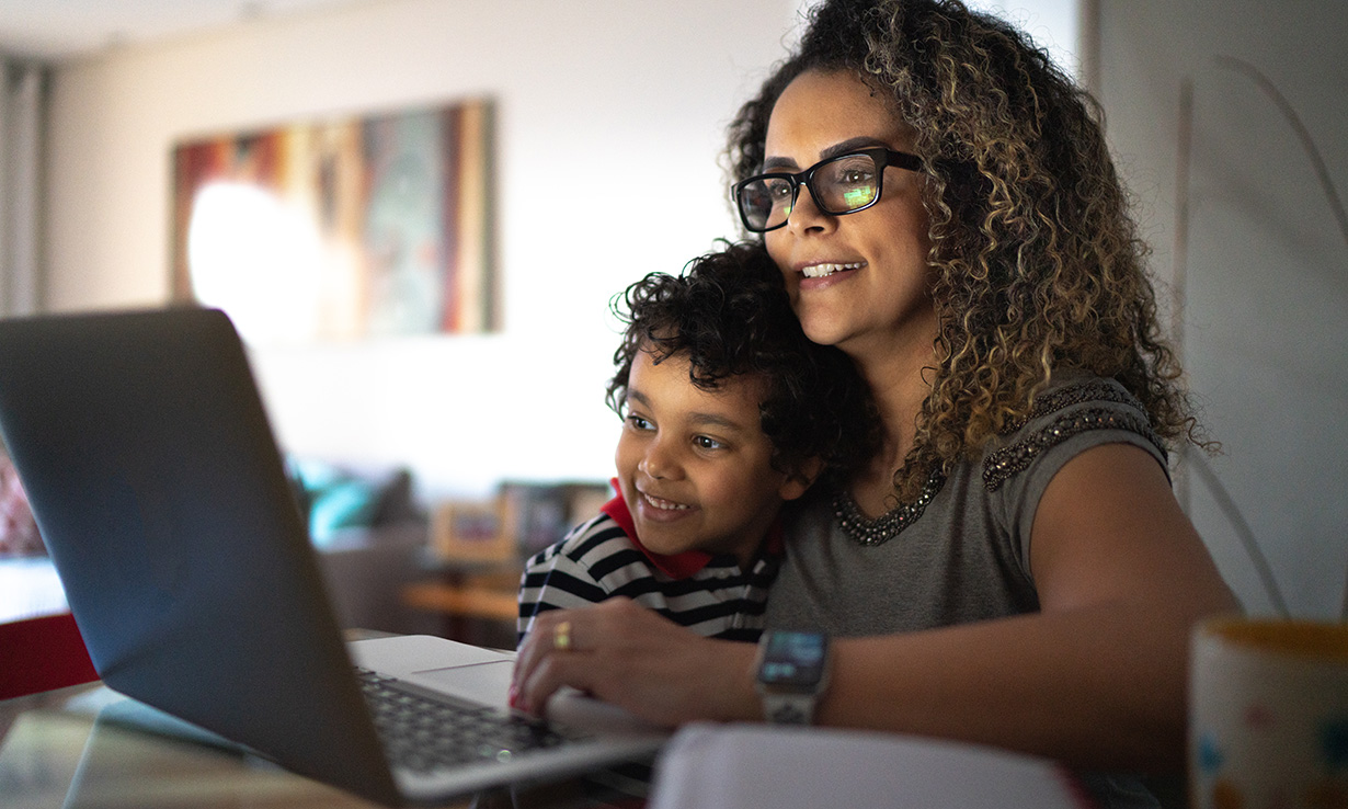 Woman and child using a laptop