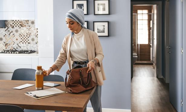 Woman using a reusable water bottle