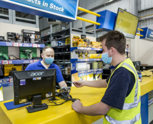 Employee and shopper in DIY store with masks