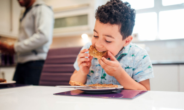 Boy eating buttered toast