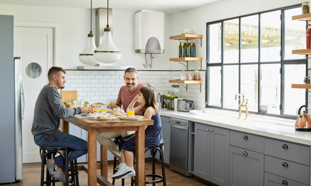 family in kitchen eating a dining table
