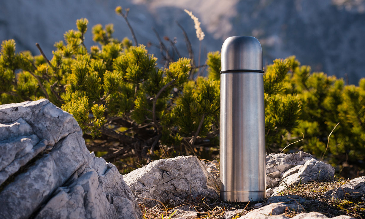 Thermos flask on rocks