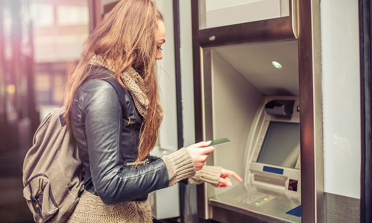 Student using the ATM