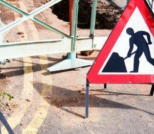 NRSWA Re-assessment courses nationwide - street work signs laid out on road