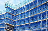 Temporary works coordinator courses - building with temporary scaffolding, blue