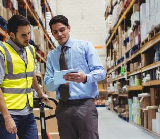 IOSH Managing Safely Refresher courses. Manager keeping staff safe in warehouse.
