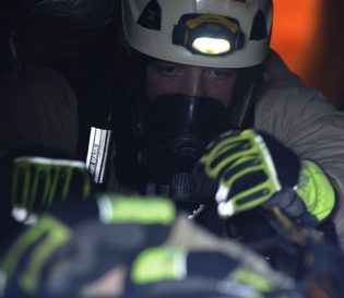 Worker in confined space with PPE.