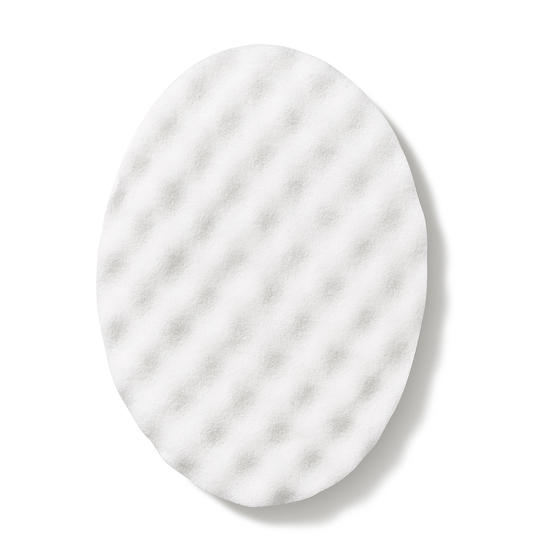 Facial cleansing sponge from QMS Medicosmetics designed to gently exfoliate and stimulate the skin