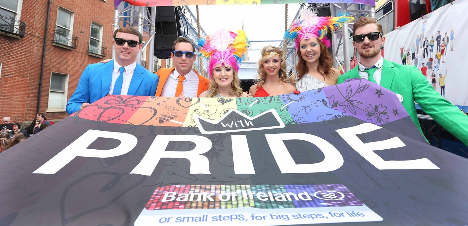 People, Person, Banner, Emblem, Flag, Crowd, Parade, Carnival, Festival, Sunglasses, Text, Poster, Advertisement, Flyer, Paper, Photo Booth