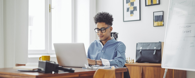 Person, Sitting, Table, Furniture, Laptop, Electronics, Desk, Sunglasses, Accessories, Female