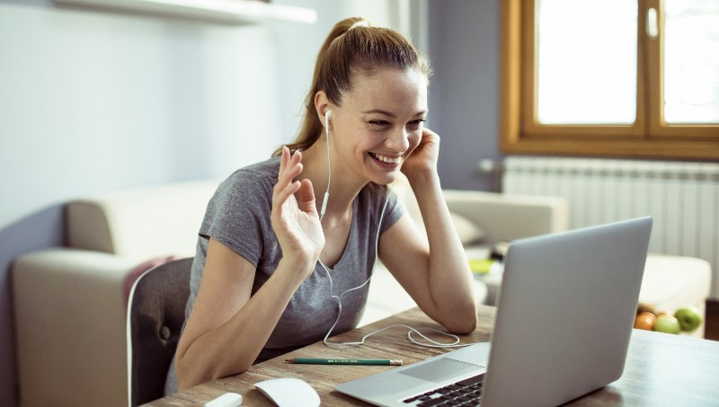 Woman having a conversation through video chat on her computer