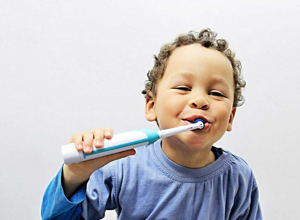 child using a toothbrush