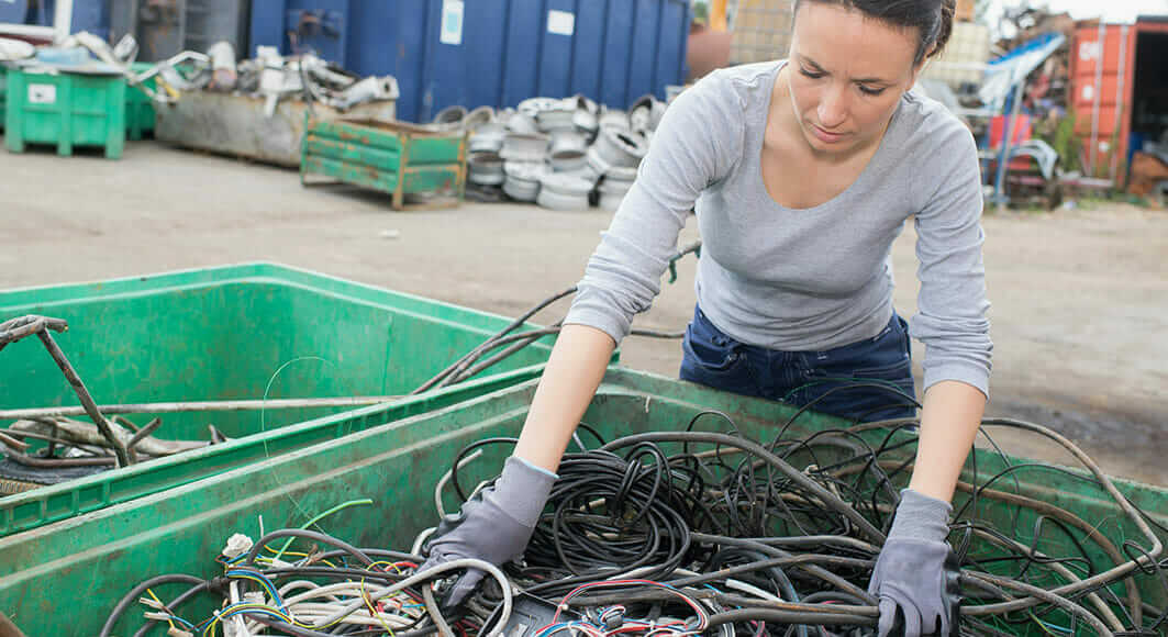 A photo of a woman sorting cables