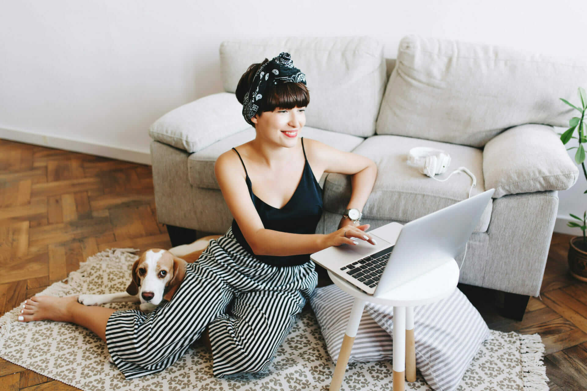 A woman using a laptop at home