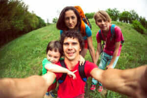 young family taking a selfie with mobile phone
