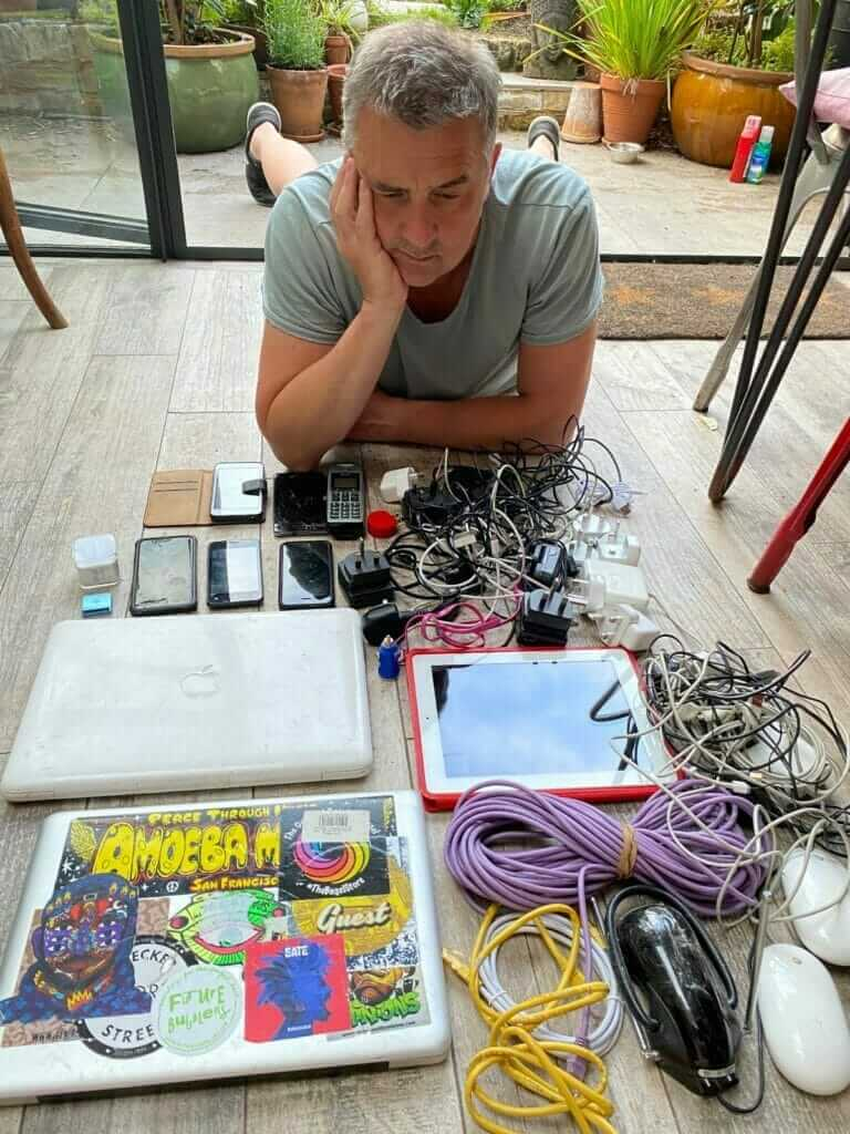 Steve looking at collection of unwanted electrical items.