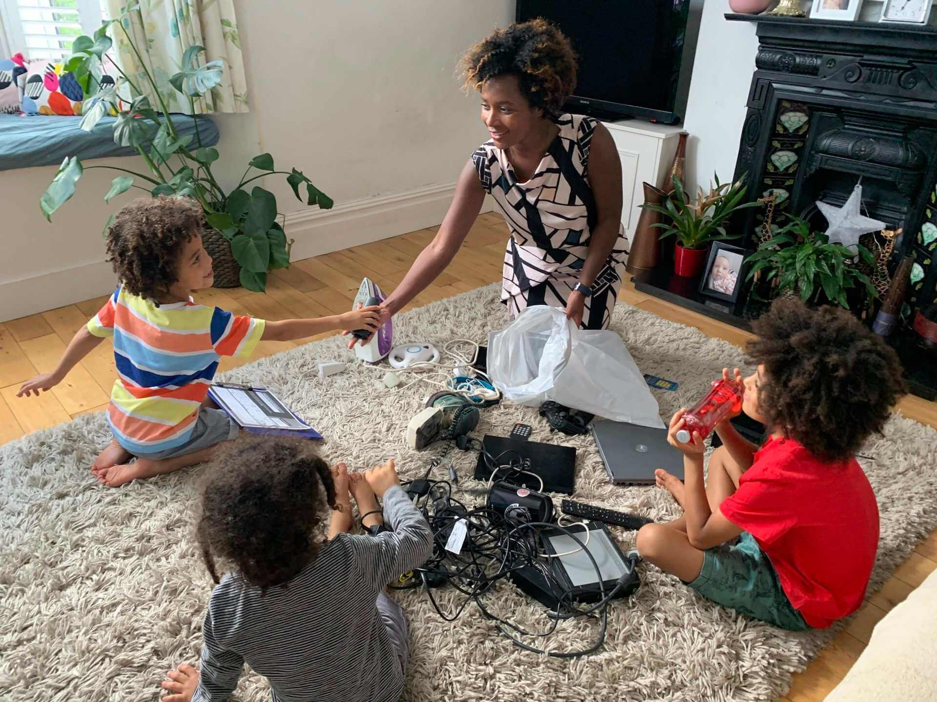 family sorting electricals for recycling