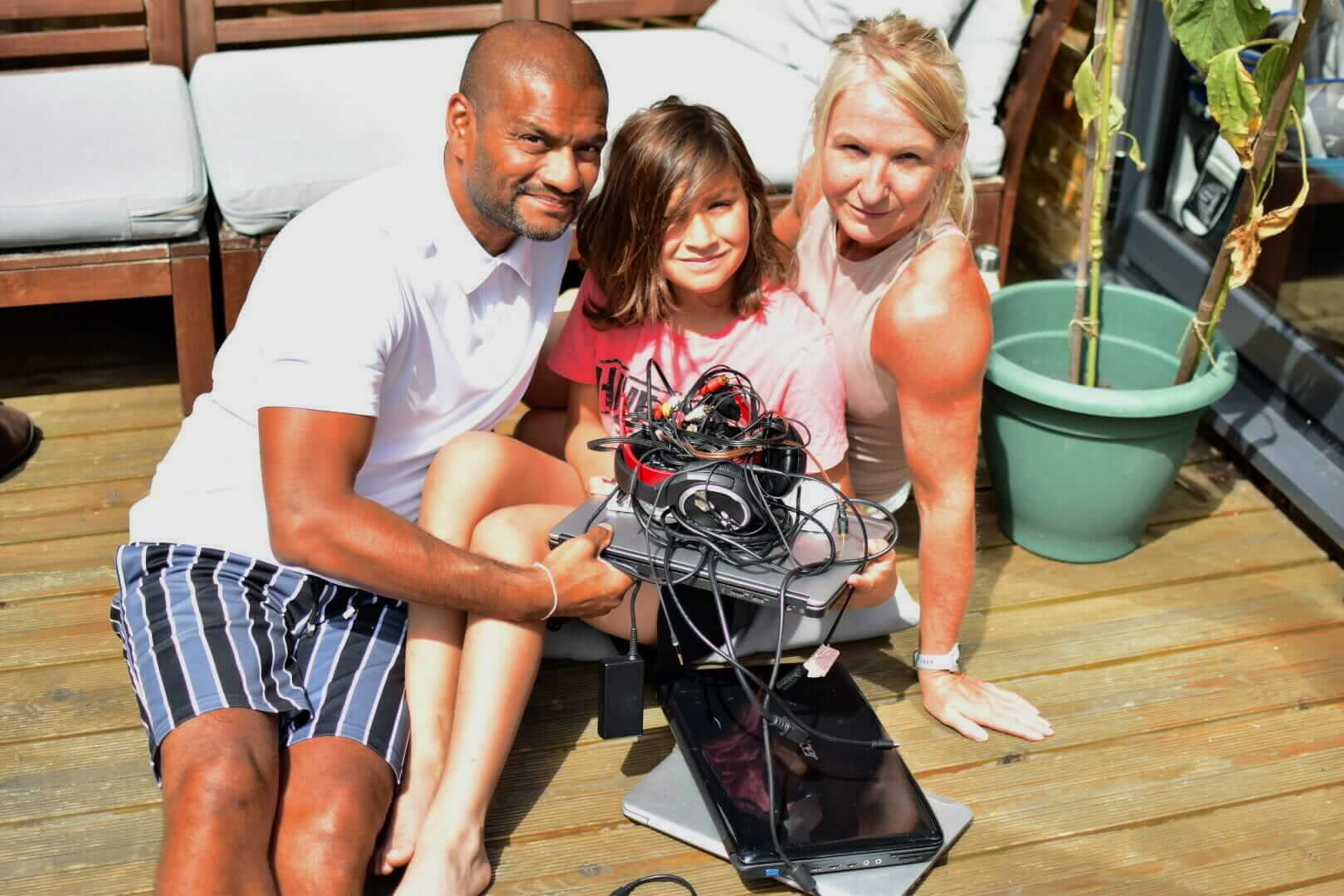 Sam with family and electricals for recycling
