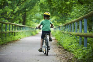 child on bike in country lane