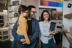 family buying toaster in store