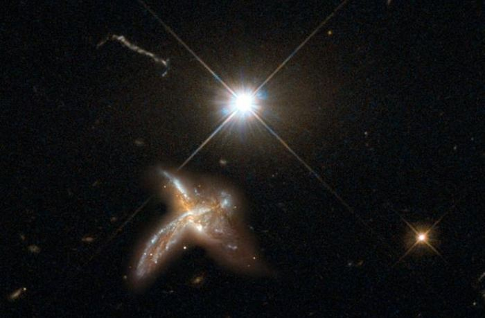 Une illustration d'artiste d'un Quasar et d'une galaxie au tout début de l'univers - Max Planck Institute for Astronomy/NASA/ESA Hubble Space Telescope