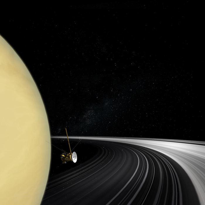 Une illustration d'artiste de la sonde Cassini, présentée sur une photo réelle de Saturne et ses anneaux pendant que Cassini traversait le plan de l'anneau - Crédit : NASA/JPL-Caltech