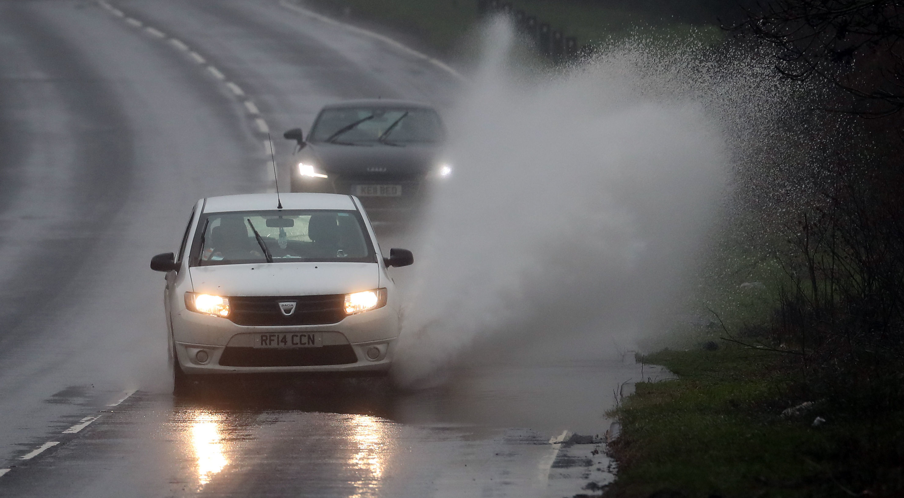 UK weather: Flood warnings as snow gives way to heavy rain