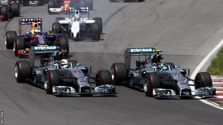 Mercedes Formula One driver Nico Rosberg of Germany cuts inside teammate Mercedes Formula One driver Lewis Hamilton of Britain during the Canadian F1 Grand Prix