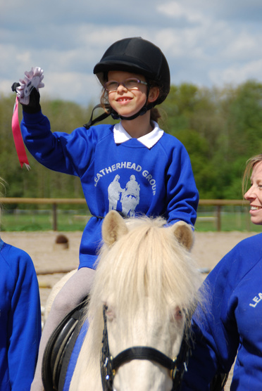 Laura Smithers of Leatherhead riding Beano shows off her rosette