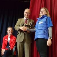 David Cowan presents the Cowan Challenge Trophy to young volunteer of the year Georgia Bud