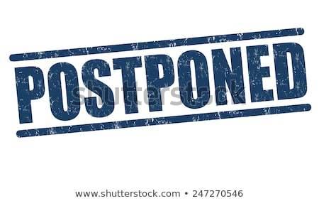 Postponed grunge rubber stamp on 450w 247270546