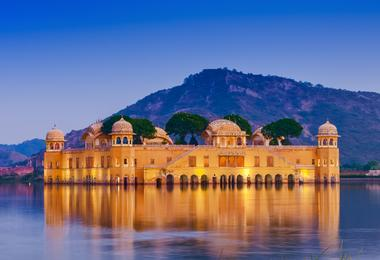 The blue waters of the lake contrast with the sand-coloured Lake Palace in Udaipur